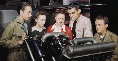 WWII students looking at an Engine