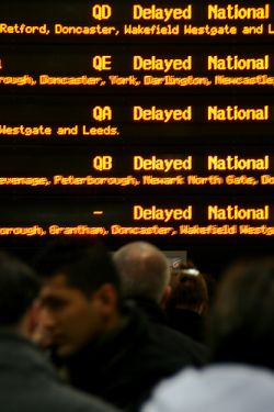 Photo of display board showing delayed trains, by Glenn Scott