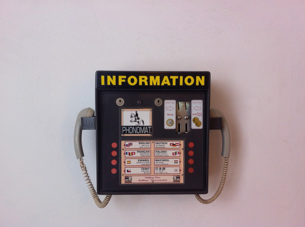 Image by Paul Keller: a multi-langage wallmounted telephone with the word 'Information' across the top