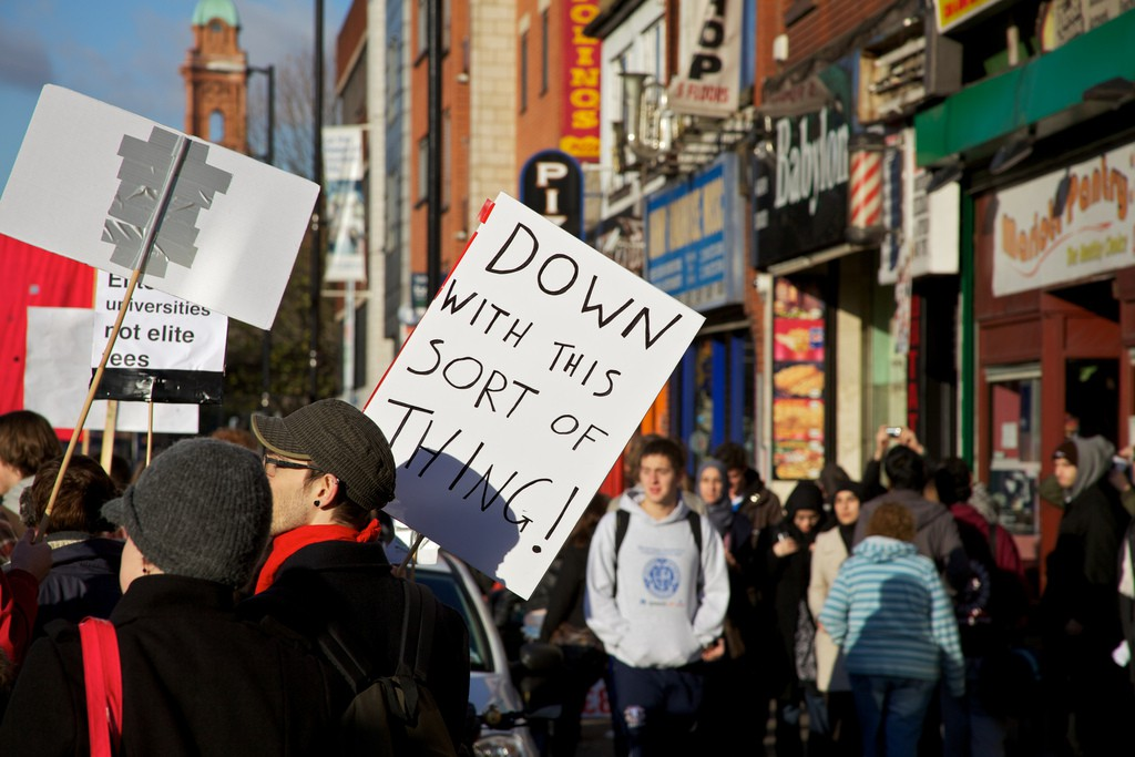 Image by Pete Birkinshaw: a student protest including a prominent sign reading 'Down with this sort of thing!'