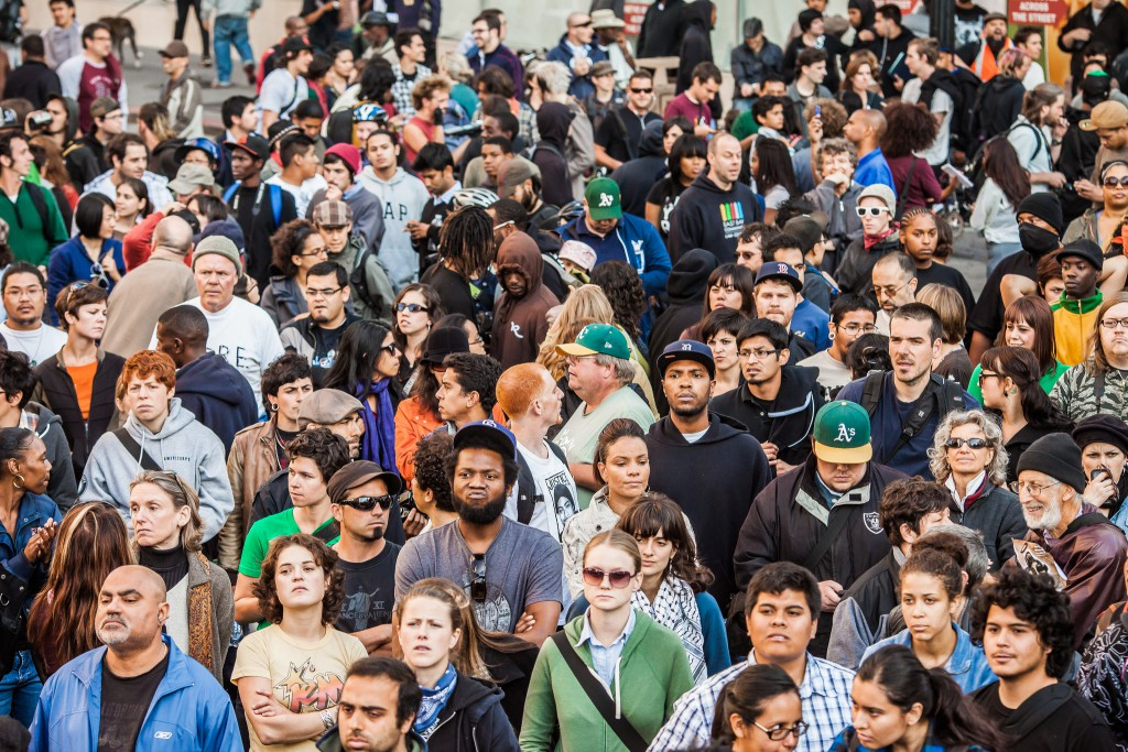 Image by Thomas Hawk - a corwd of people all looking in the same direction