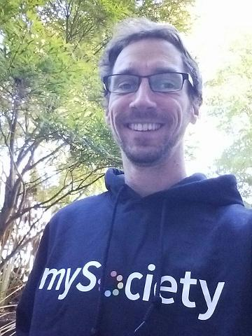 Andy in a mySociety hoodie