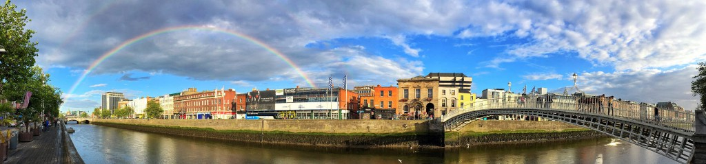 Image by Brad Herman. A rainbow over a river in Dublin.