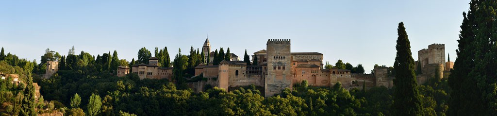 Alhambra on a hilltop surrounded by trees, by Javi Muro