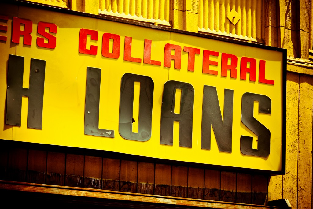 Image by Thomas Hawk. Large yellow sign with black letters advertising loans.