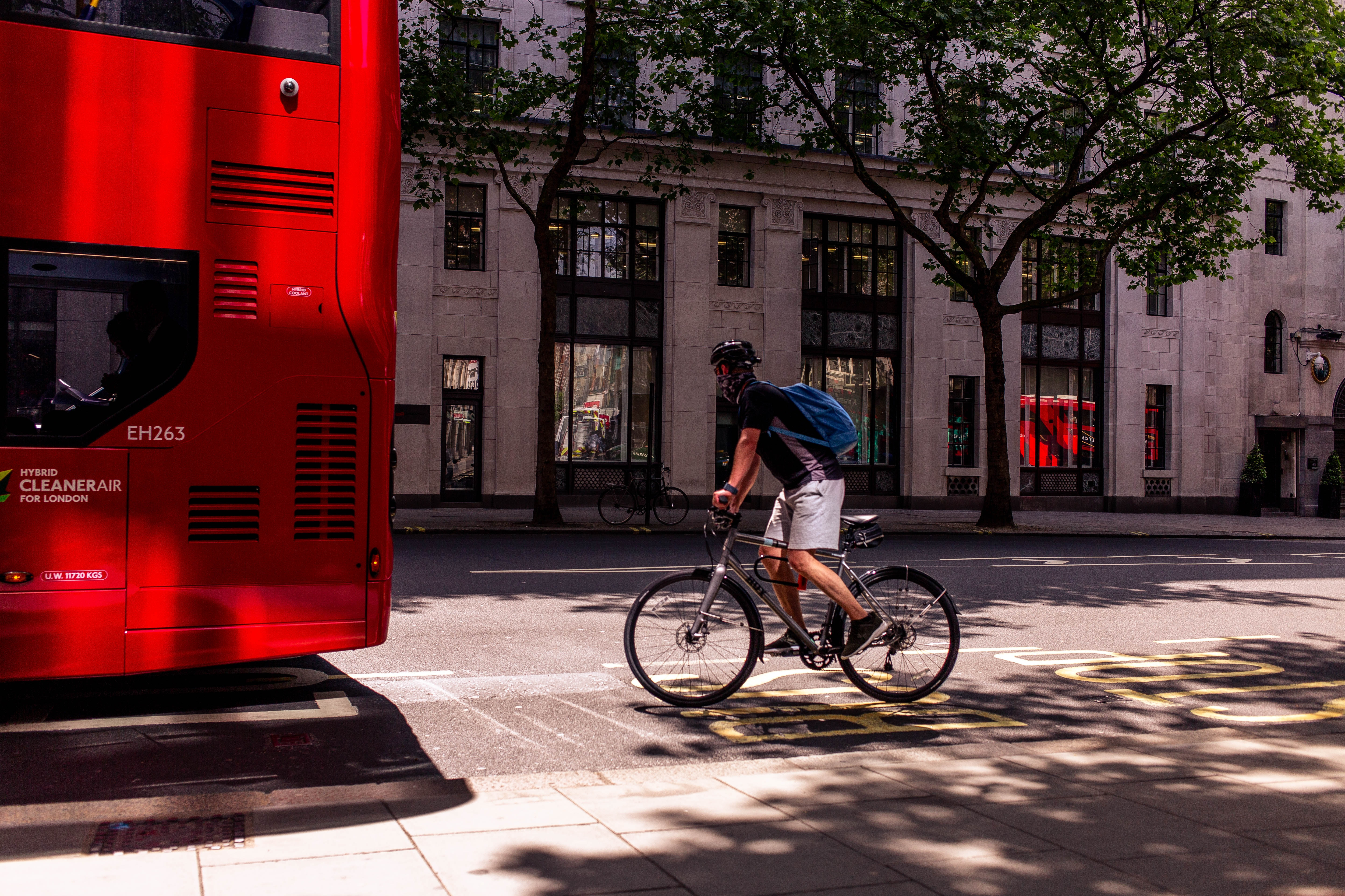 Image by Charisse Kenion | A cyclist behind a London bus