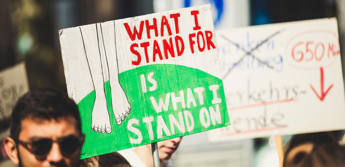 Image by Markus Spiske - a sign saying 'what I stand for is what I stand on'